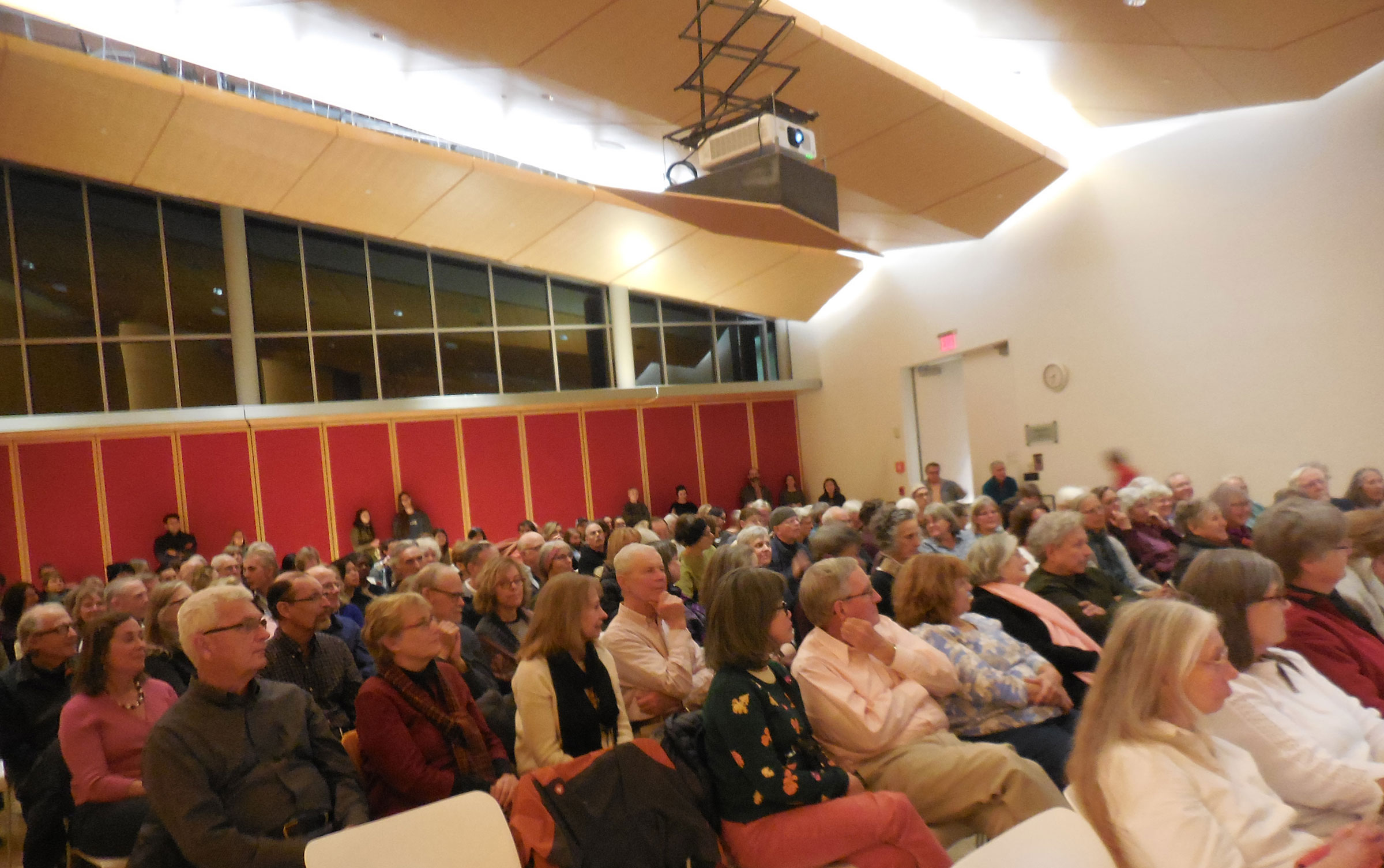 "The audience at Smith College listened to the talk on ""space for well-being"""