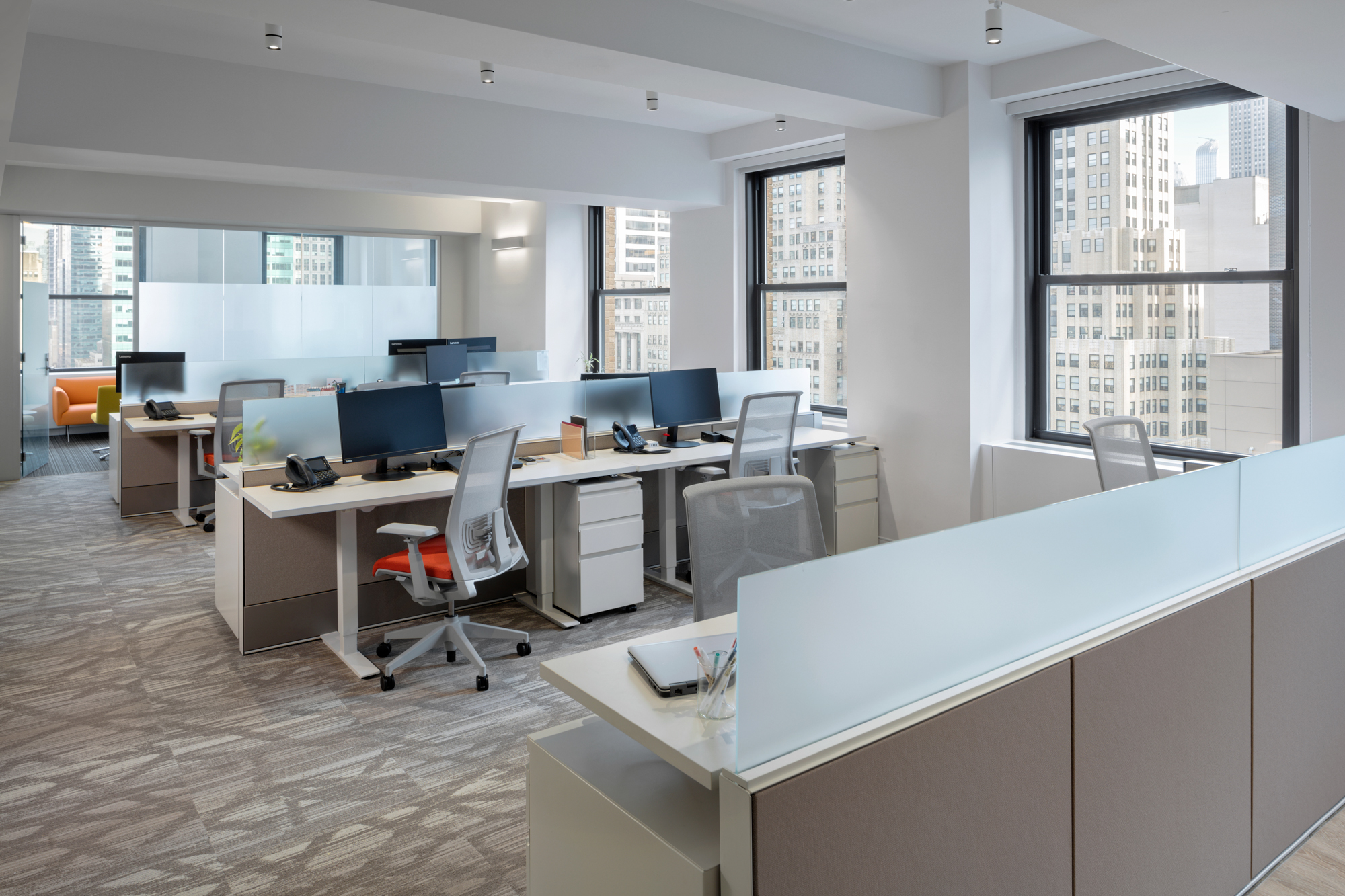 The open space encourages communication. Sit-stand desks & ergonomic chairs help people's health.